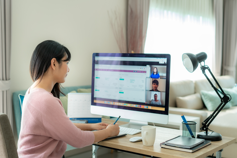 Woman at desk videoconferencing